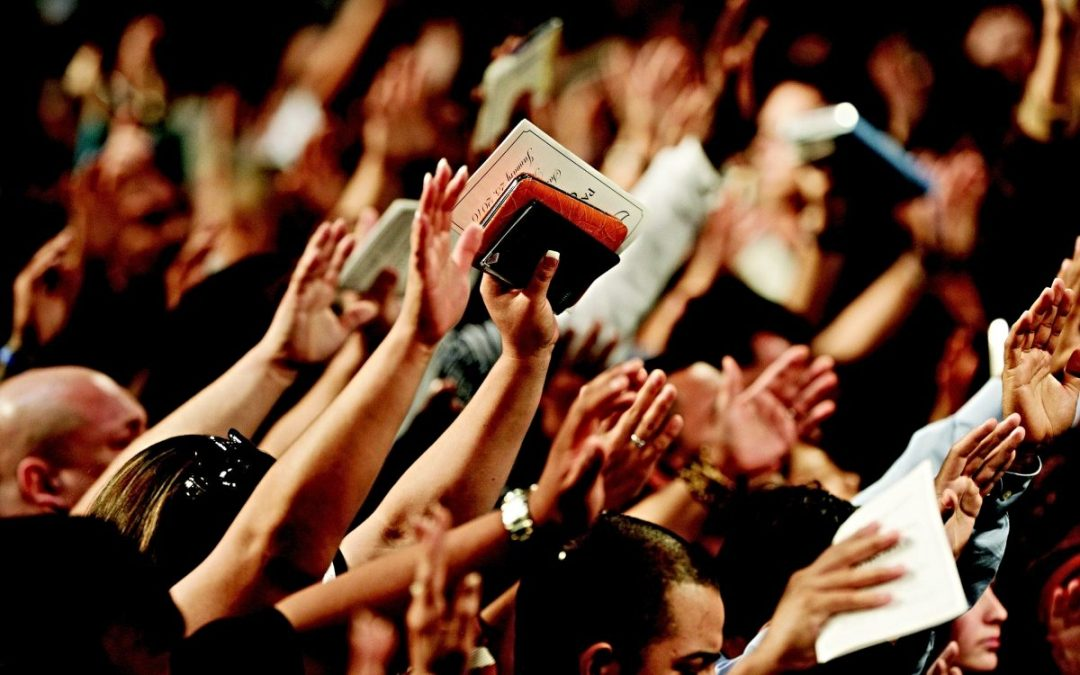 Hands raised in worship service