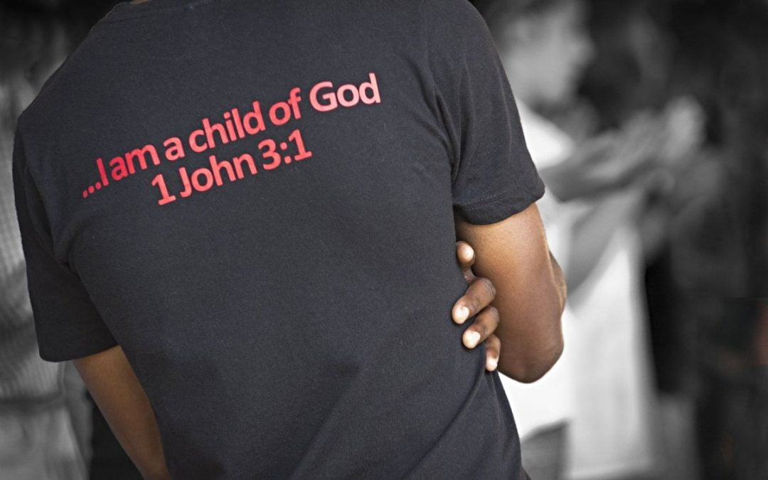Young black man with T-shirt with 1 John 3:1