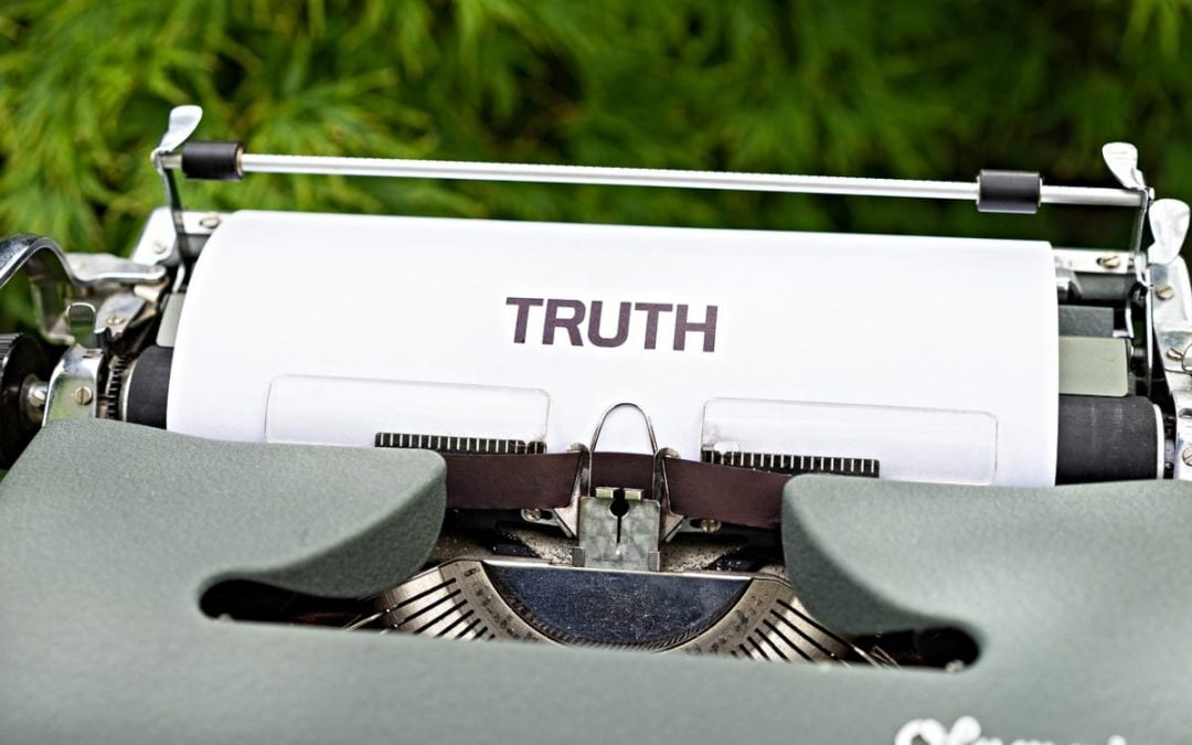 Typewriter with the word 'truth' typed on paper