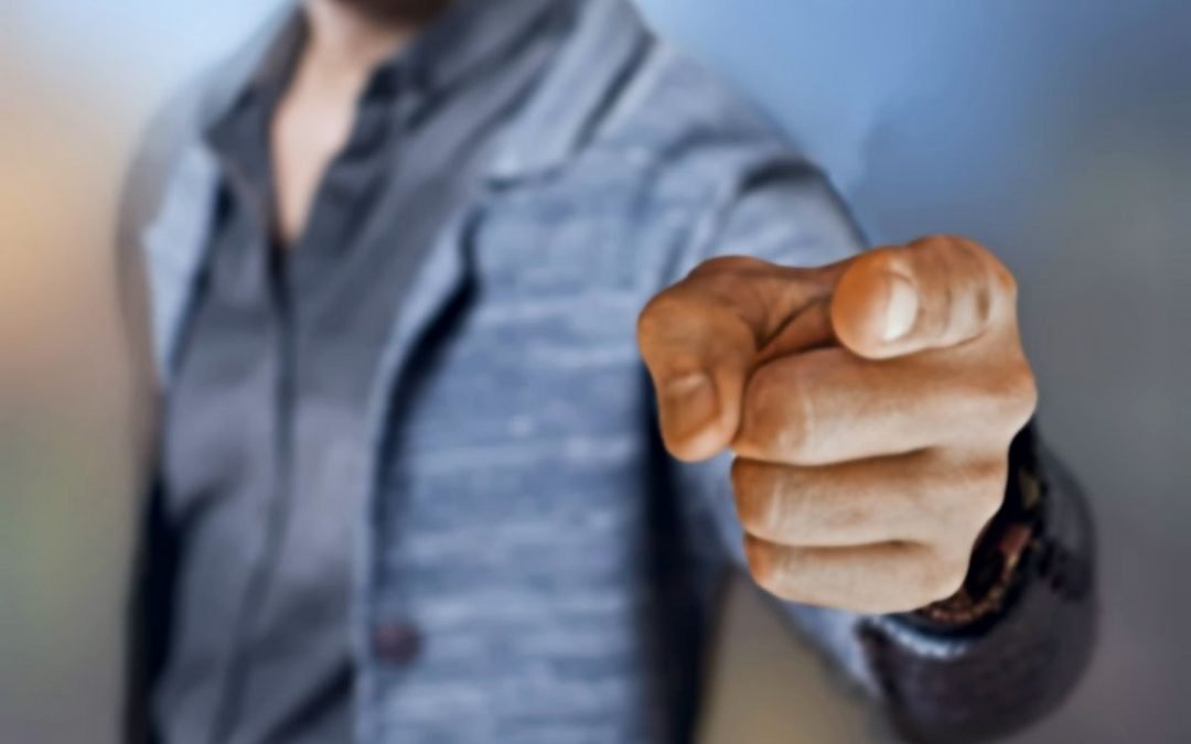 Man pointing finger forward