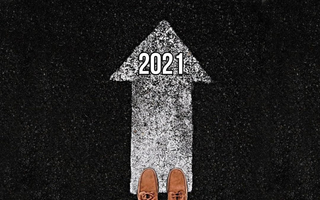 Feet standing at end of arrow pointing forward to 2021