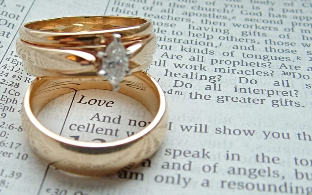 wedding rings on an open Bible