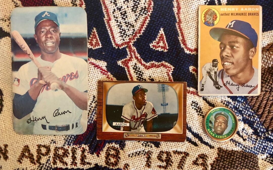 Hank Aaron baseball cards sitting on a quilt