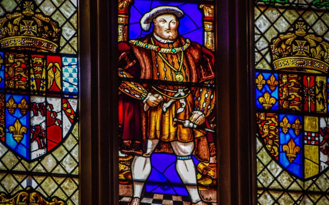 A stained glass window featuring Henry VIII.