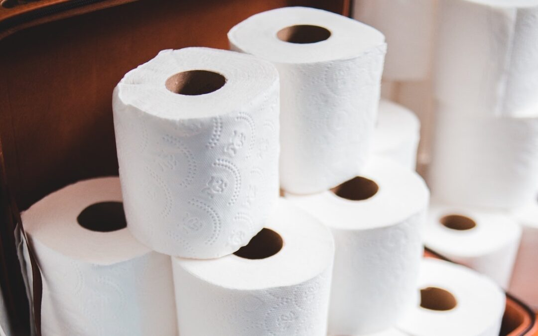 A stack of toilet paper sitting on the floor.