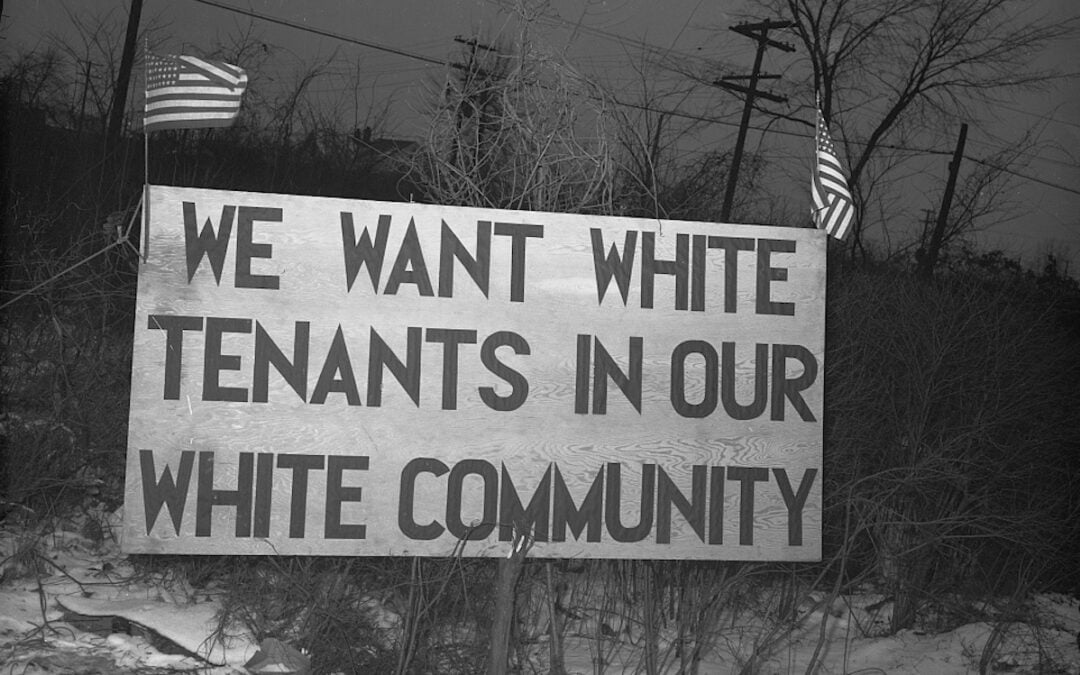"A sign outside Sojourner Truth Homes, a U.S. federal housing project in Detroit, Michigan, in 1942, that read, ""We want white tenants in our white community."""