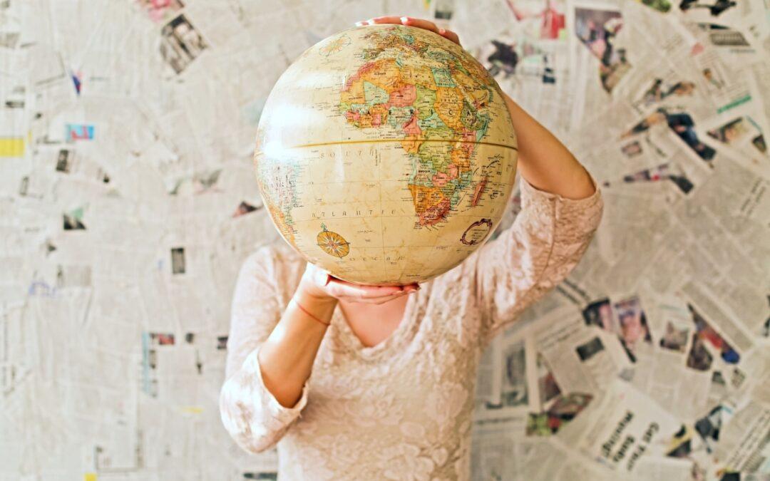Woman holding up globe