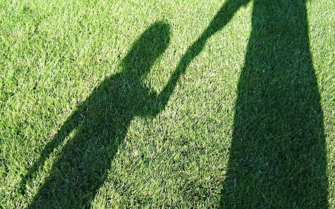 Shadow of mother and child holding hands