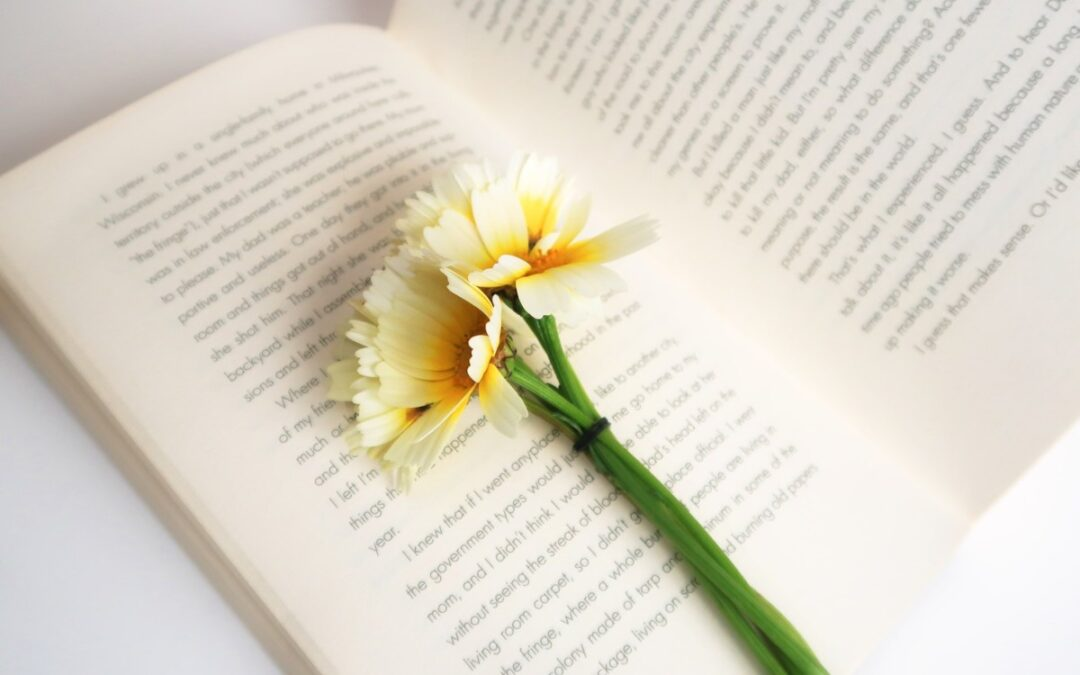 Yellow flower on open book