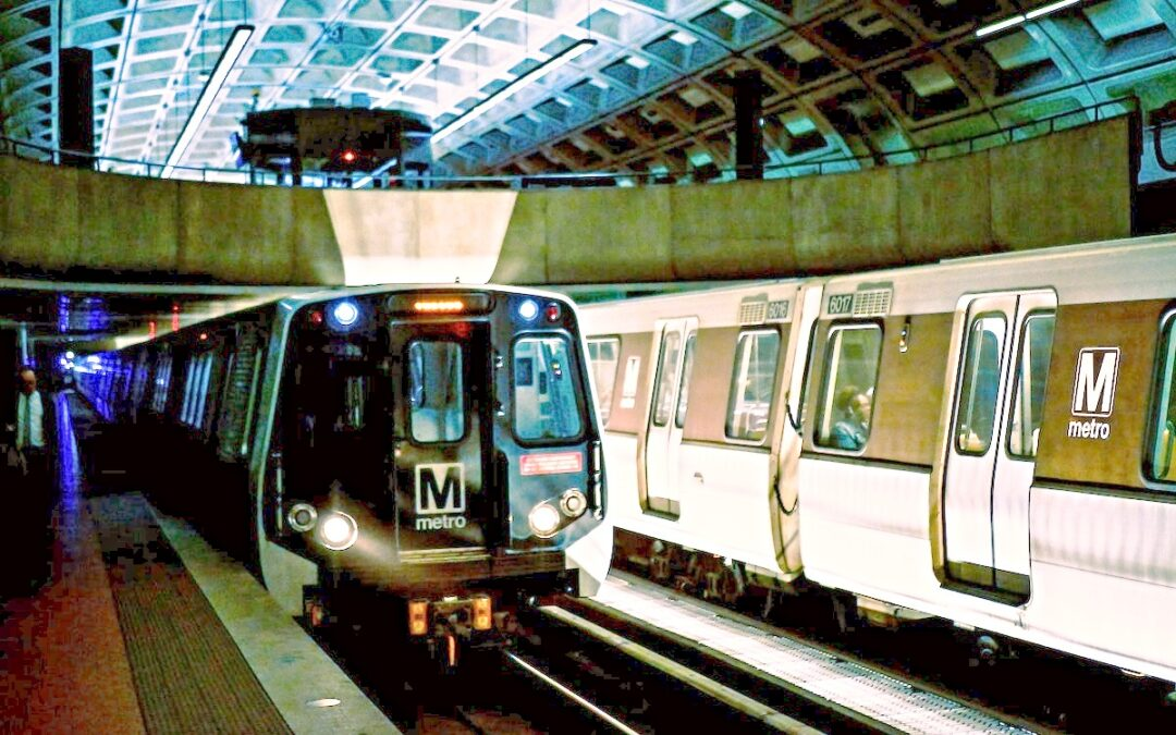 An underground metro train pulling away from the station.