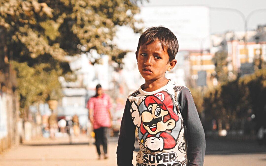 Disheveled boy looking at camera