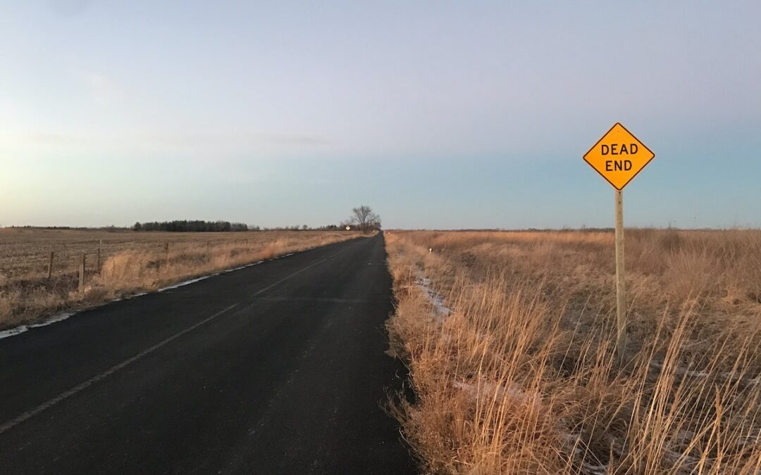 """A """"Dead End"""" sign on a country road."""