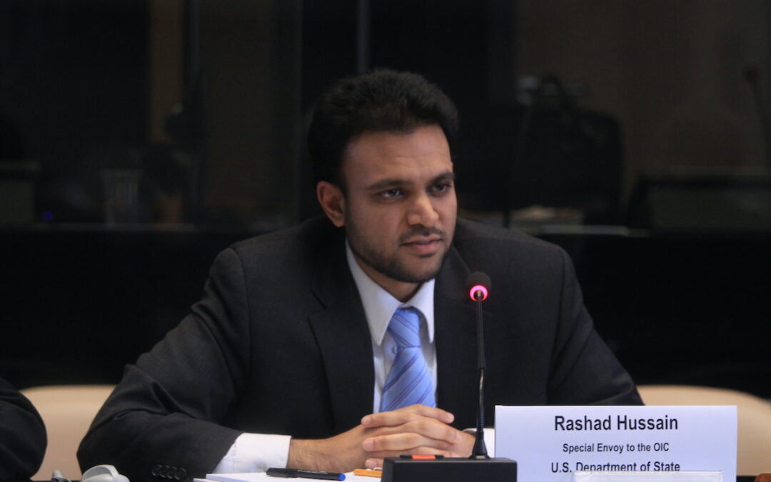 Rashad Hussain sitting at a table speaking at a WHO meeting in 2010.