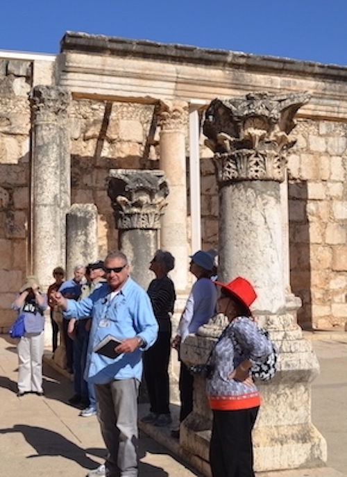 Tourists standing outside a synagogue in Capernaum