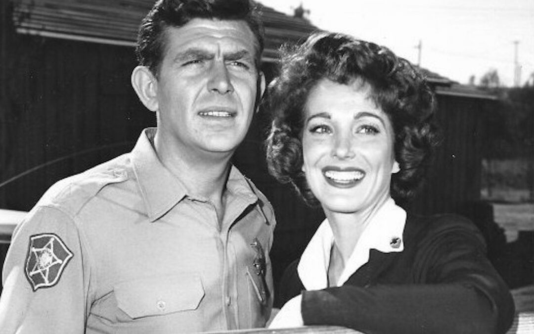 """A black-and-white Andy Griffith and Julie Adams as the county nurse from the television program """"The Andy Griffith Show."""""""