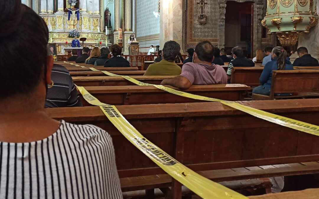 A church in Mexico during the COVID-19 pandemic with certain seats blocked off to maintain social distancing.