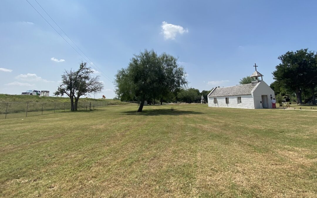 """A small chapel in South Texas on """"disputed"""" border land. On the left is a border patrol truck just beyond the fence."""