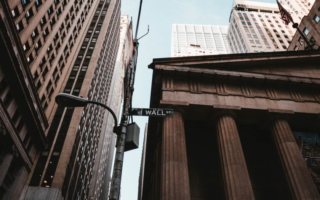 A black-and-white photo of a Wall Street sign.